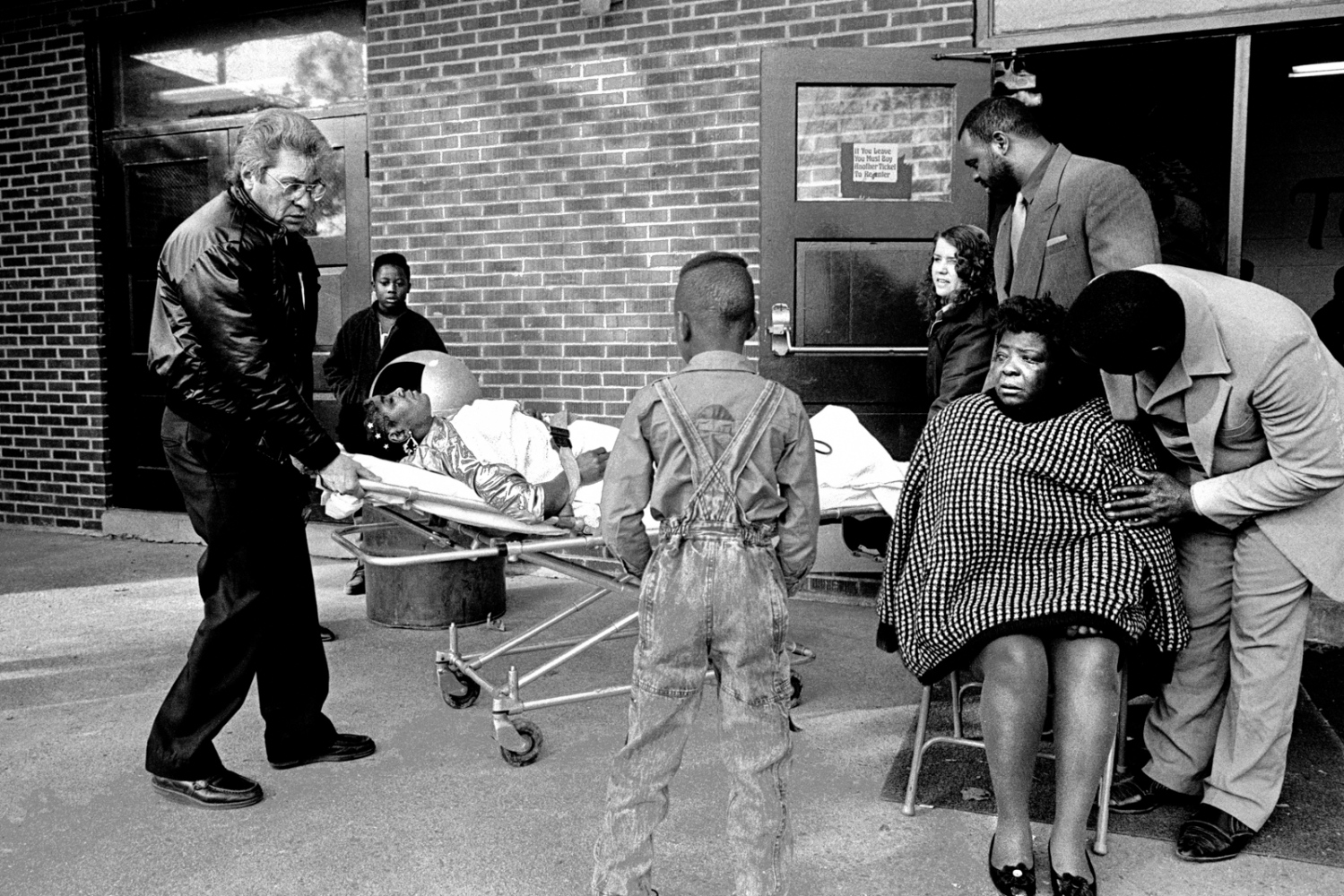 "Ether Ree Hall Gaston is wheeled out of the funeral on a stretcher after collapsing from grief. She was in jail the day of the fire. In her eulogy, Ether said, ""I wasn't there for you, but deep down inside I know you all knew I loved every one of you."" 1993"