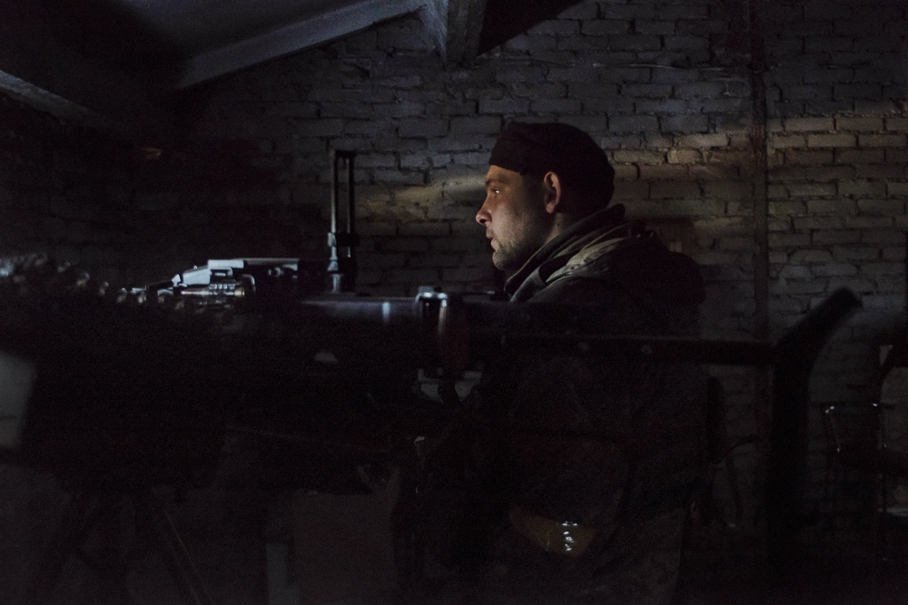 A Ukrainain soldier operates a machine gun 100 meters from seperatist positions in Avdiivka, Ukraine.