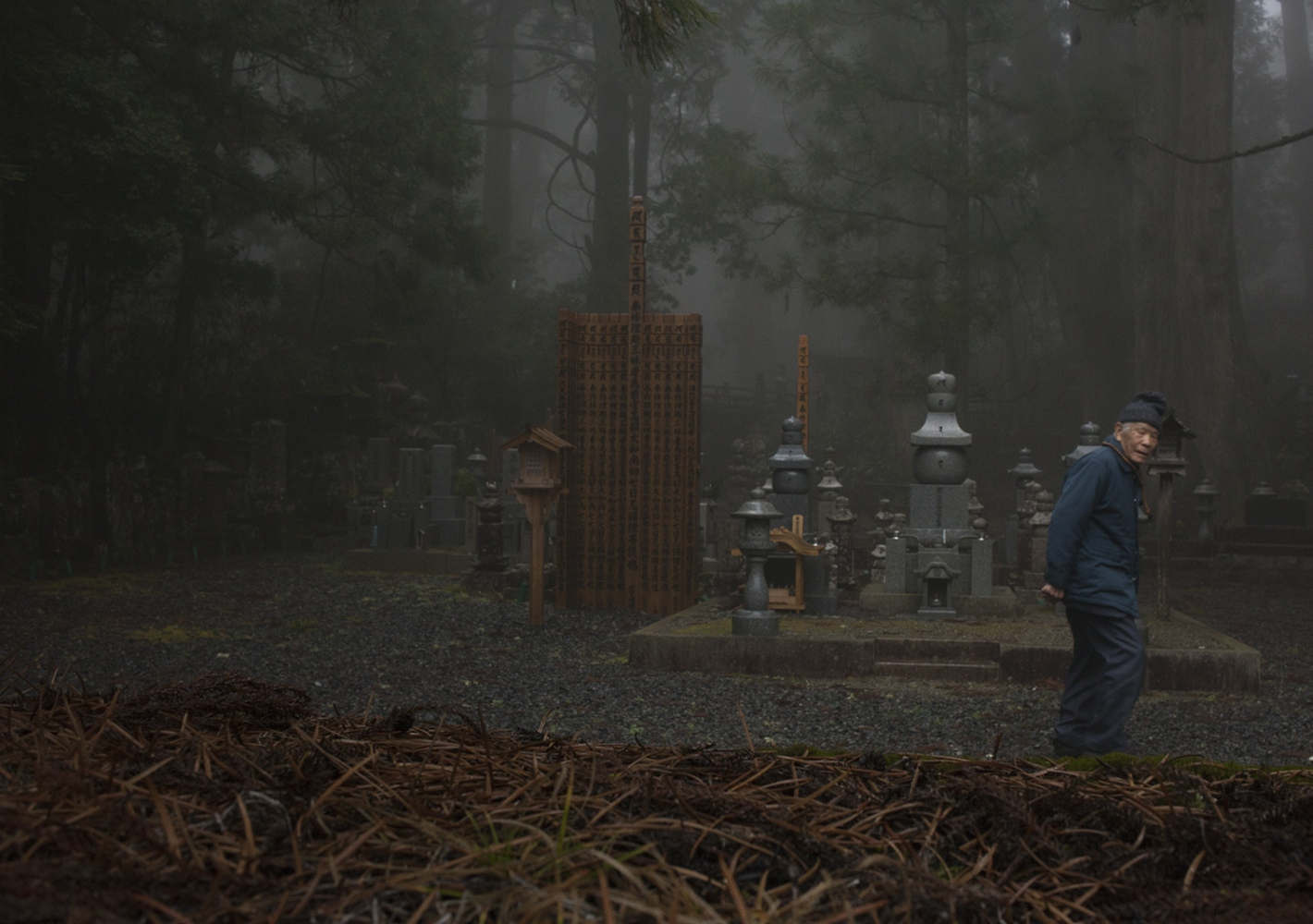 Elderly man walking in the cemetery, Japan 2015.