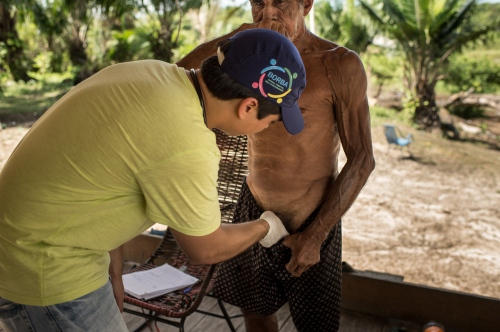 Doctor Luiz Pessoa examines a patient in an indigenous community on Rio Madeira, June 15, 2015. Doctors and dentists working with the  Basic Health Unit River (BFHU) system, provide primary care visiting indigenous communities via the   Igaracu, a boat outfitted and designed to provide medical and dental assistance. They v isit these communities during a 20 day period up and down parts of the Amazon river and its tributaries. The Igaracu is the first government subsidized medical boat for Brazil.