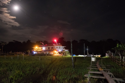 The Igaracu is lit up by it's own lights and the moon, as it sits on the edge of the Rio Negro Sunday June 21, 2015. Doctors and dentists working with the  Basic Health Unit River (BFHU) system, provide primary care visiting indigenous communities via the   Igaracu, a boat outfitted and designed to provide medical and dental assistance. They v isit these communities during a 20 day period up and down parts of the Amazon river and its tributaries. The Igaracu is the first government subsidized medical boat for Brazil.