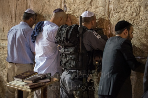An Israeli Soldier prays among other Jews during Shabbat at the Western Wall in Jerusalem, Israel April, 19, 2014. Photo Ken Cedeno