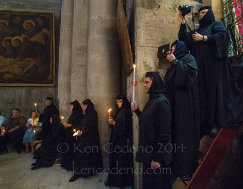 Nuns pray during Greek Orthodox church services at the Holy Church of Sepulcher in Old Jerusalem, Israel April, 19, 2014. Photo Ken Cedeno