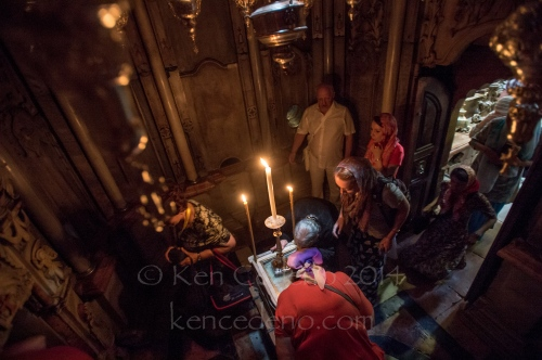 Pilgrims pray in The chapel of the Angel at the Holy Church of Sepulchre in Old Jerusalem, Israel April, 19, 2014. Photo Ken Cedeno