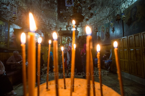 Candles are seen lit in front the Tomb of the Virgin Mary in Old Jerusalem, Israel April, 19, 2014. Photo Ken Cedeno