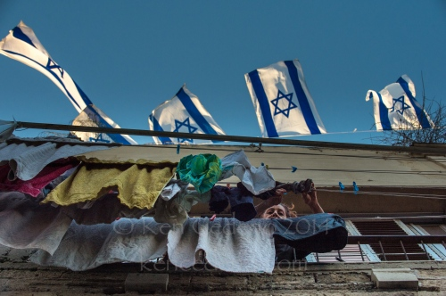 A woman hangs laundry out to dry in Old Jaffa, Israel April 30, 2014. Photo Ken Cedeno