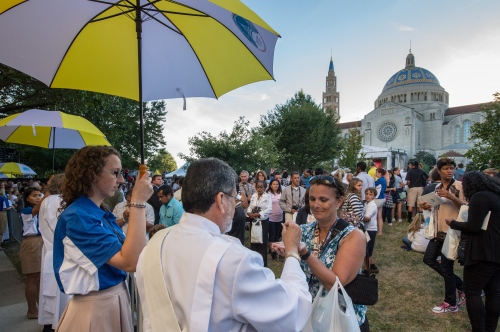 Pilgrims recieve communion during services as Pope Francis, 78, conducts mass and the Canonization of Blessed Junipero Serra at the Basilica of the National Shrine of the Immaculate Conception /The Catholic University of America, Sept 23, 2015 in Washington DC. Serra was the 18th century Franciscan missionary who founded missions and evangelized in California. This is the first canonization on US soil, and the Popes first visit to the United States. Photo