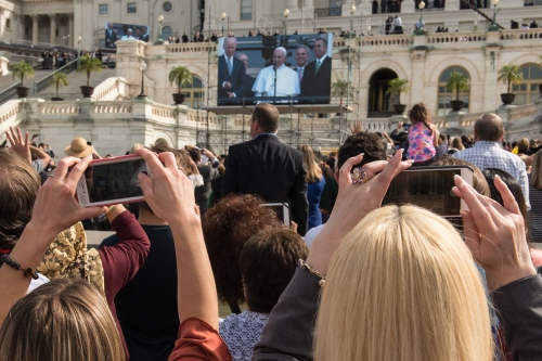 Pope Francis, 78, is seen on a jumbo-tron as he speaks to the thousands gathered on the West lawn of the US Capitol and the National Mall following his address to a joint meeting of the U.S. Congress in the House Chamber of the U.S. Capitol on September 24, 2015 in Washington, DC. Pope Francis is the first pope to address a joint meeting of Congress and will wrap up his visit here befroe heading to New York City.