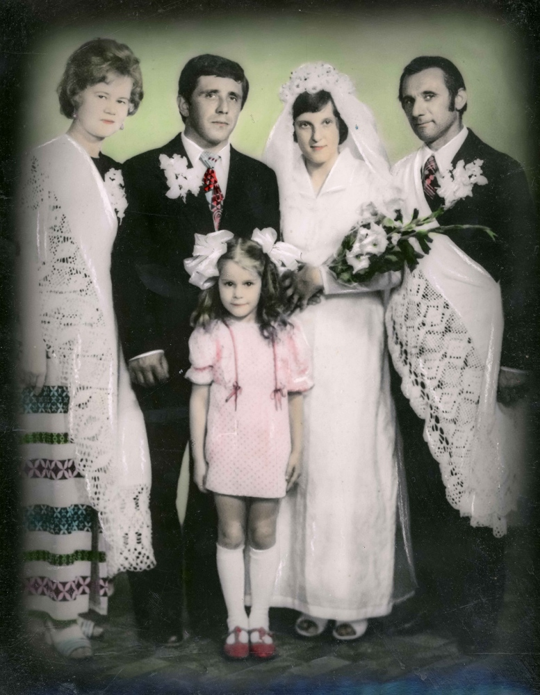 "A photo of Nina and Ion's wedding day (21st of May 1977), is stored in the family bureau. Their godparents, Tamara and Gerasim Tamara (who was also a deportee, part of the Constantinide family), stand beside them. ""I got married to [Nina], a deportee as myself, in that, her parents were deportees, and we live peacefully now. We have two boys, they have their own children, our grandchildren, and we are retired. Now, we stay at home and rest!… I am happy with my life, except for the fact that we were oppressed. I lost a brother [in Siberia] and our parents suffered a lot. Imagine how it was to move with 5 children all the way to Siberia, where it is -40/-45 Celsius. How can you deal with such a situation? We managed somehow. I thank our parents,"" - Ion"