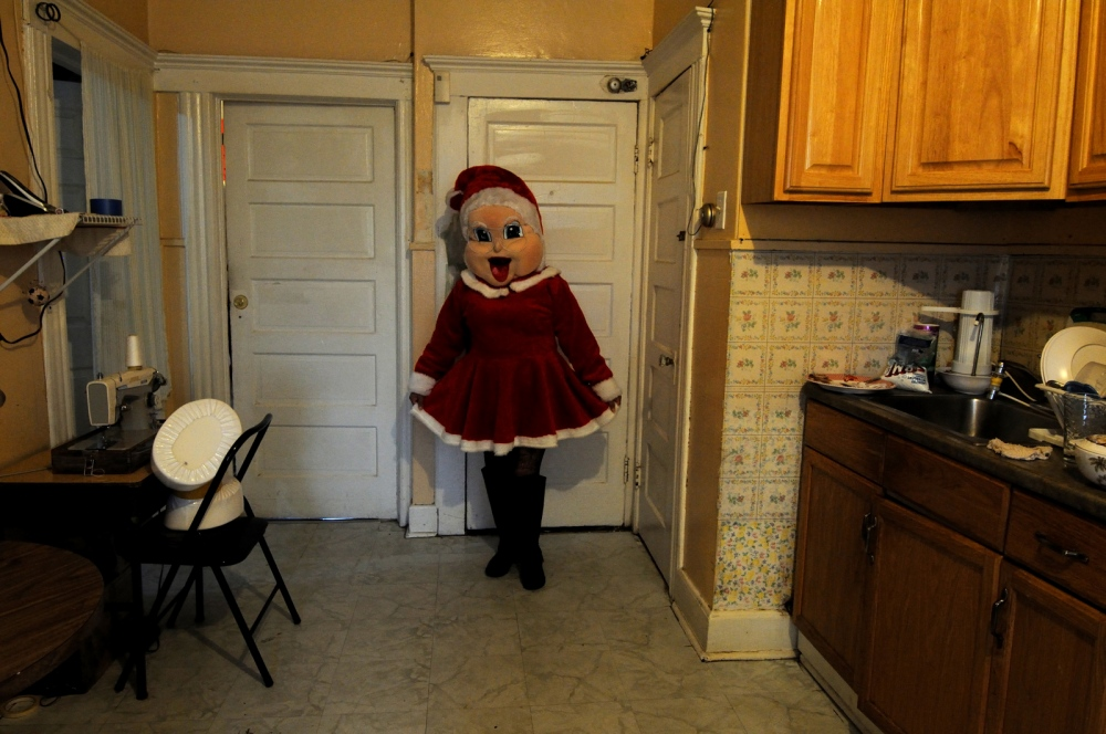 Doña Berta,55, from Mexico poses in her Mama Noel costume at her house.