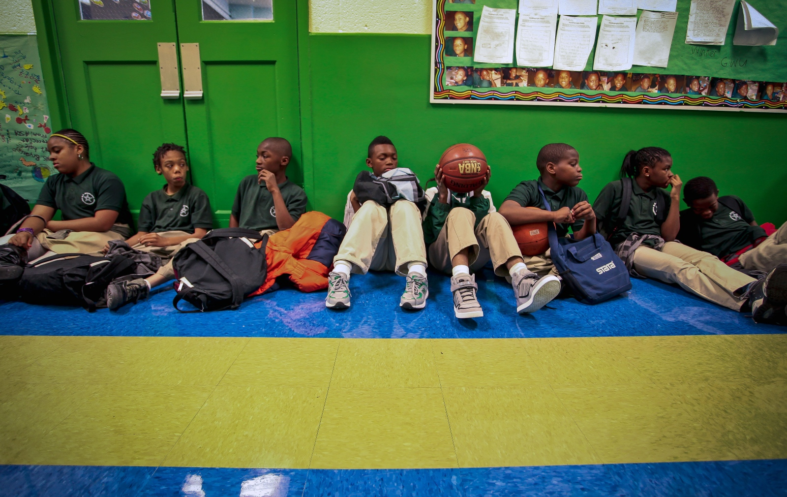 Students wait to go outside for recess. Many of the students love playing basketball and there is even a girls football team that is slowly being formed.