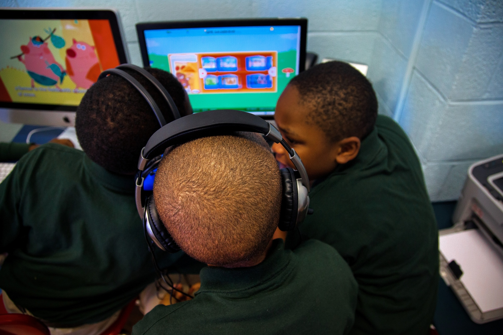 Three students sit together and solve a reading game on Stanton Elementary's computers during 'centers' time, a period when student go on their own to different areas of the classroom to complete lessons.