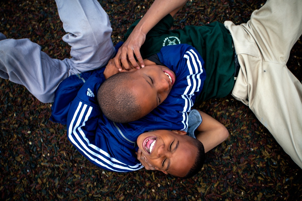 Two students play wrestle on Stanton Elementary's playground during recess.