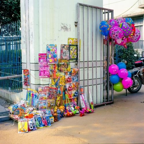 Vendors sell ballons and children's toys outside of a small city hospital in the Jiangxi province of China.