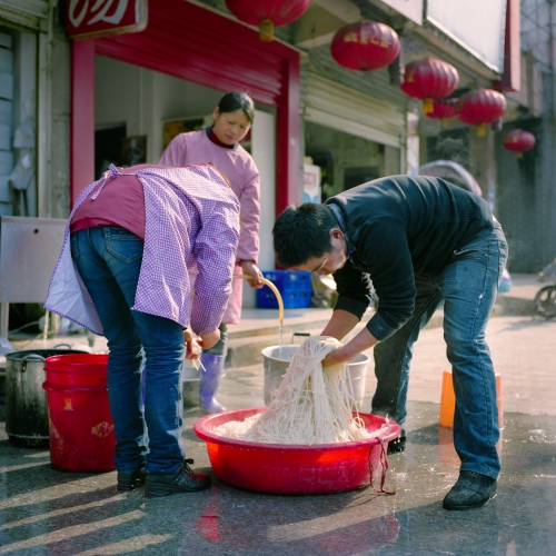 Restaurant workers wash noodles in Ji'an, China.