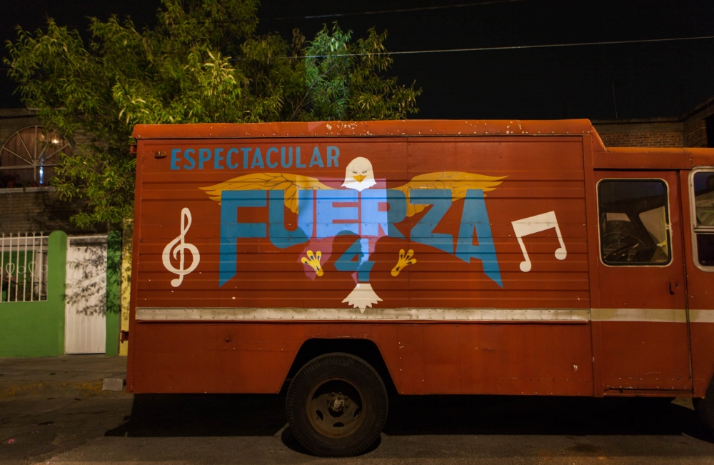 · Fuerza 4, a band truck in the annual  anniversary party of Bosques de Aragon neighborhood. Besides Sonideros playing all night long, there are events for all family members with local band and food stalls.  A ragón, Mexico City. February, 2015. // ·Fuerza 4, troca de espetaculos en la fiesta anual de Bosques de Aragon. Aparte de Sonidos presentes durante toda la noche, la fiesta ofrece otros eventos como bandas y puestos de comida.  Aragon, Mexico D.F. Febrero, 2015.