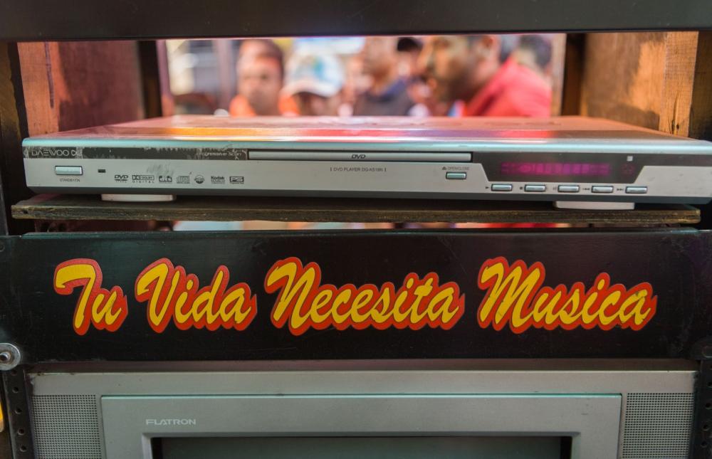 """· Your life needs music"""" slogan sticker on music equipment belonging to one of the most influential sonideros, Sonido Sonoramico, led by brothers Manuel and Raúl Lopez. Tepito, México D.F. October, 2009. // ·""""Tu vida necesita musica"""" sticker en equipo de Sonido Sonoramico en la fiesta de Aniversario de Tepito. Tepito, Mexico D.F. Octubre 2009"""