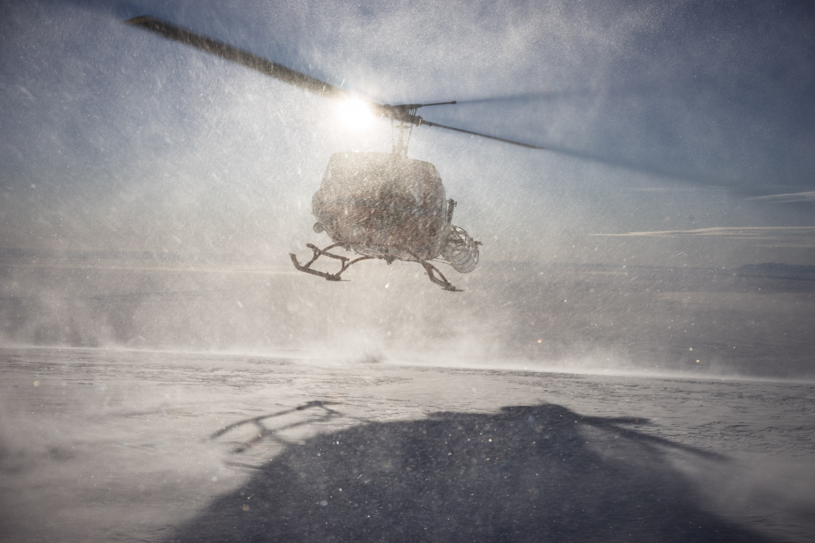 27 November 2015. A National Science Foundation Bell 212 helicopter lands to pick up the science group on the glaciated flank of Mt. Erebus' south side after a site installation.