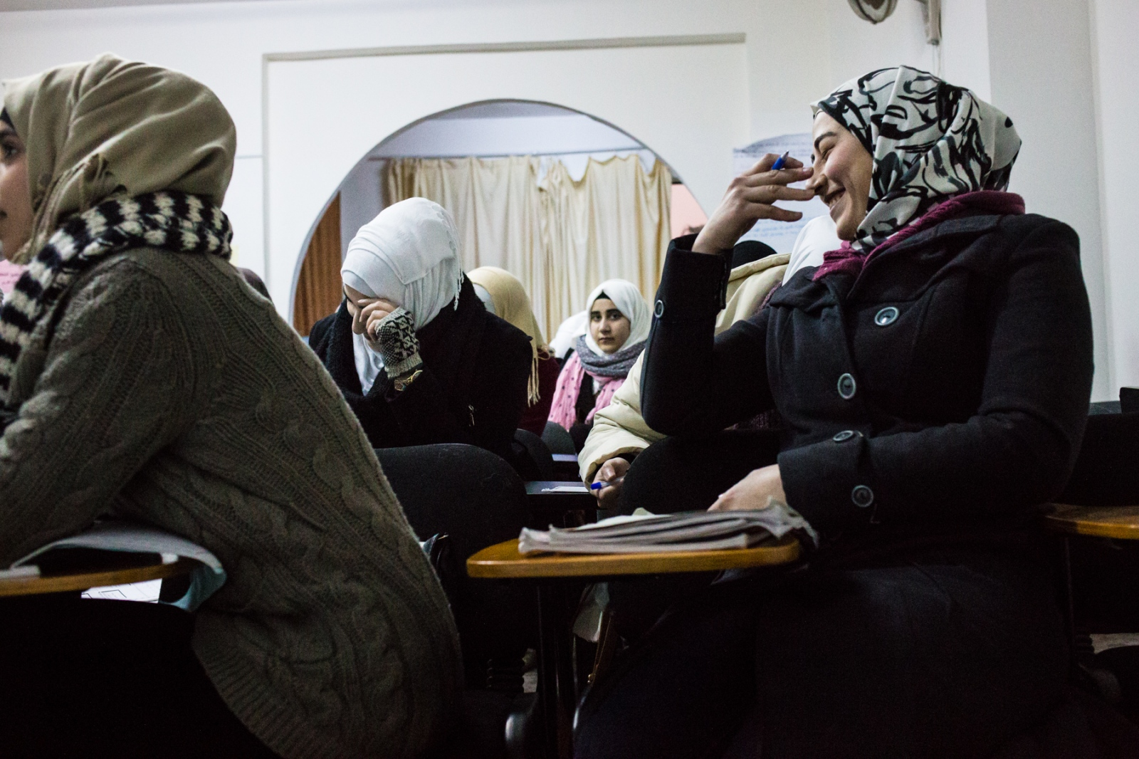 Young Syrian women attend classes at Suriyat Without Borders, a local NGO in Amman, Jordan that provides free classes and medical care to help Syrian refugees in Jordan recover and move on in their lives there.