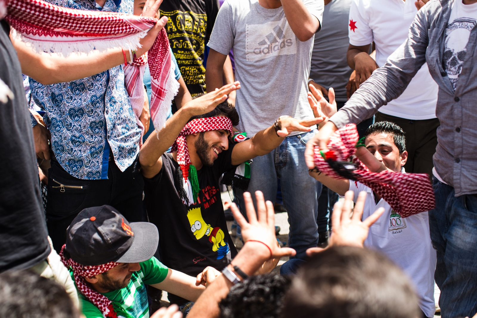 An impromptu breakdancing circle breaks out in a crowd as people watched an Autostrad concert, a Jordanian rock band. The concert was part of celebrations marking the 100th anniversary of the Great Arab Revolt on June 3, 2016 in Amman, Jordan.
