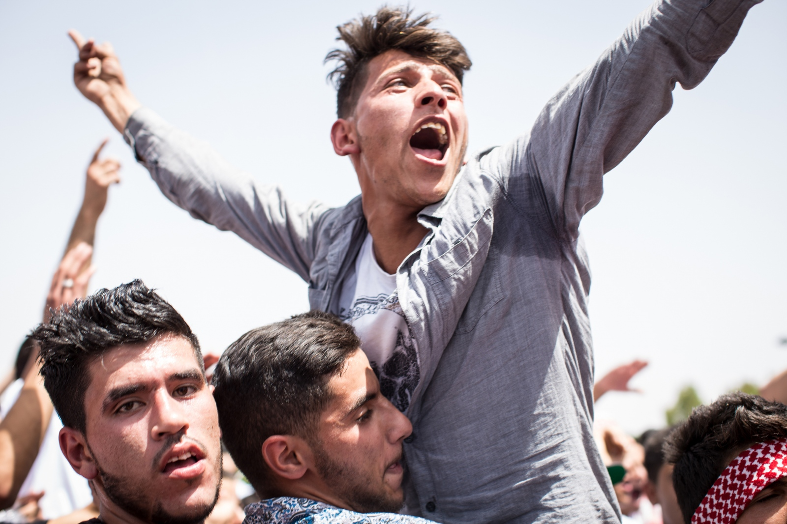 The crowd cheers as the Jordanian rock band Autostrad performs at a festival celebrating the 100th anniversary of the Great Arab Revolt in Amman, Jordan, on June 3, 2016.