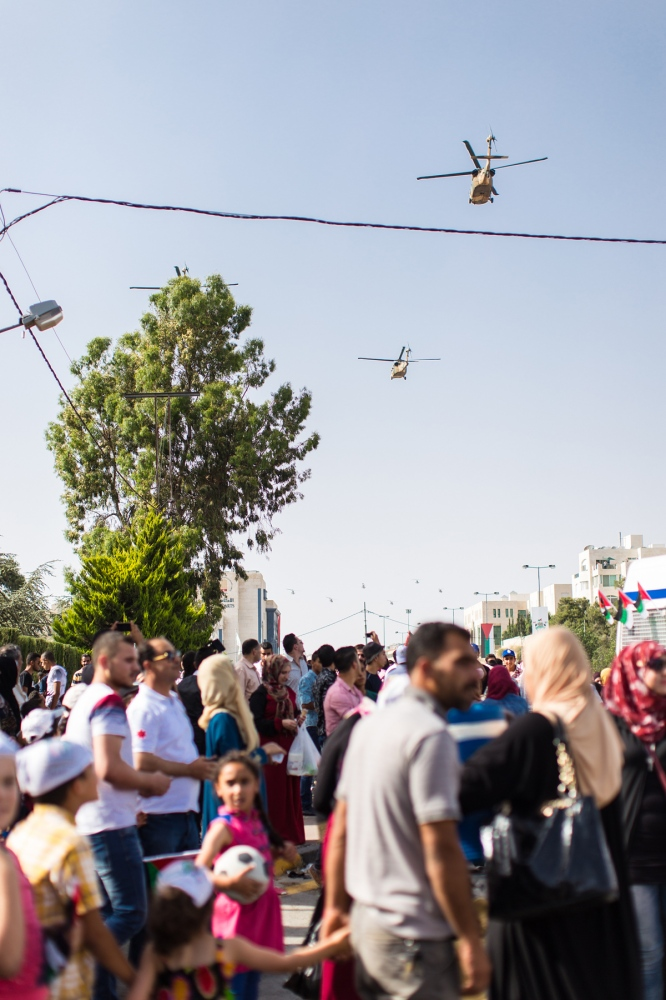 Helicopters from the Royal Jordanian Air Force fly overhead during an airshow celebrating the 100th anniversary of the Great Arab Revolt in Amman, Jordan, on June 3, 2016.