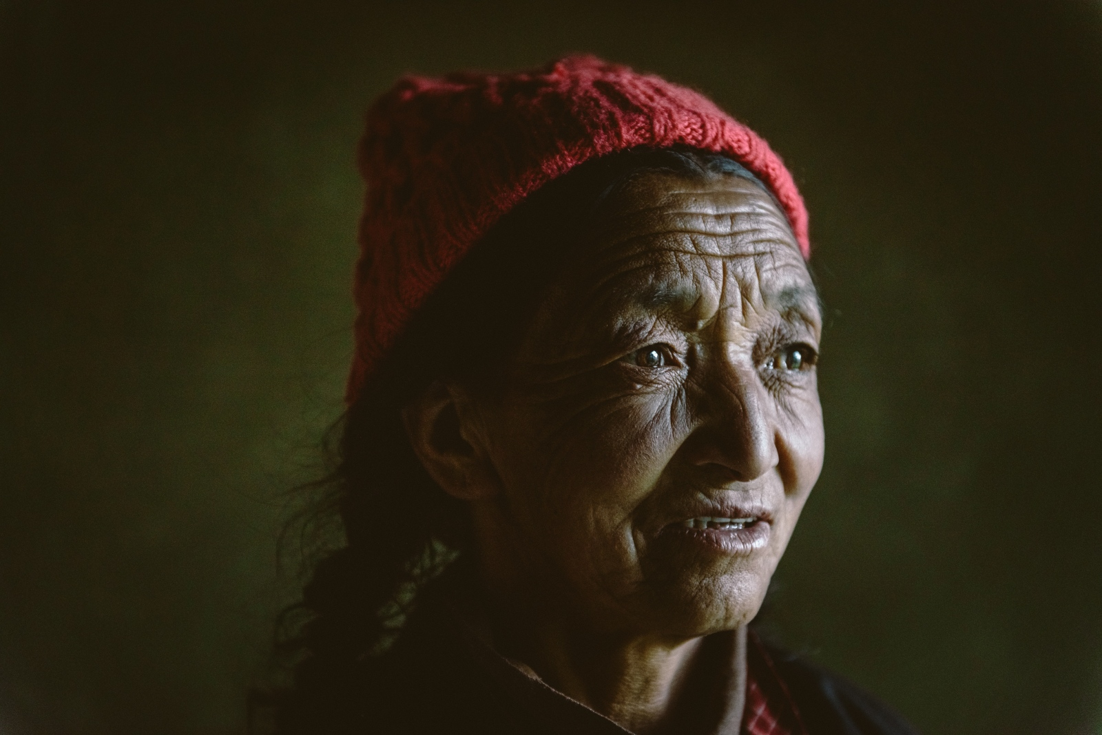 Tsering 'Dolker' Fomsapa, an elder Ladakhi woman of the remote mountain village, Domkhar Gongma, and witness to the 2010 'cloudburst' storm event that devastated the region of Ladakh, destroying entire villages and claiming entire families. Her family and her home were saved from disaster by virtue of being situated higher up on the mountain side whilst the destructive flash floods passed by just below.