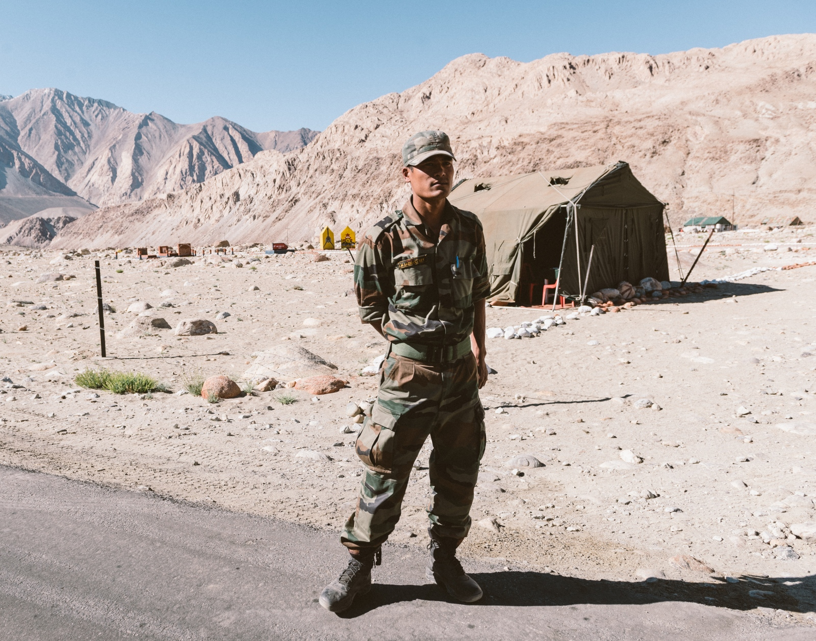 A soldier of the Indian Armed Forces stands guard at a military checkpoint leading to Nubra and Shyok Valley. The valleys are geopolitically sensitive areas tucked within the Karakoram mountain ranges and are restricted to non-military personnel due to its contested status between India and China and Pakistan.