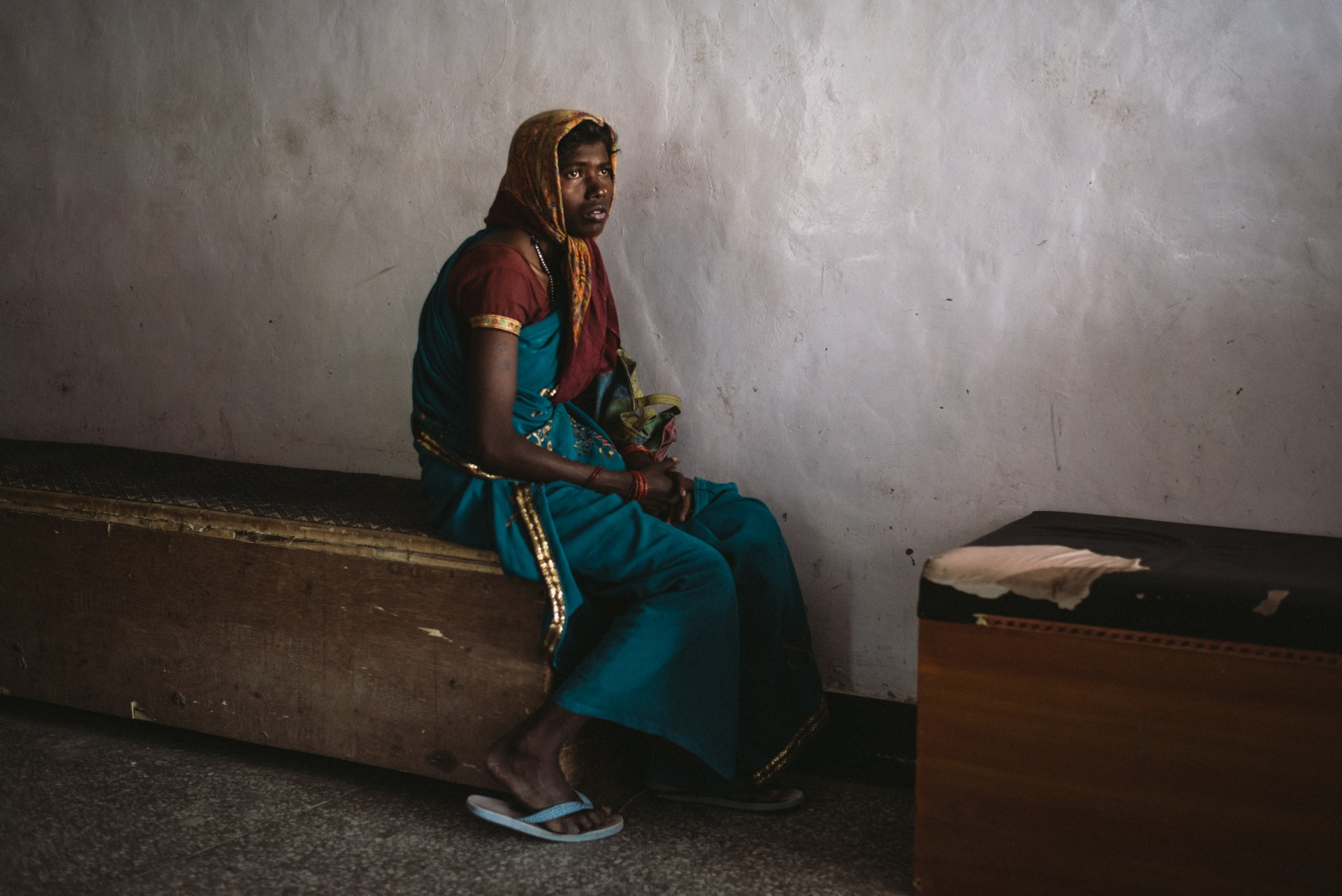An immigrant Bihari woman awaits outside the maternity ward at the overcrowded and understaffed Sonam Norboo Memorial Hospital in Leh. The lack of doctors, medical equipment and resources makes healthcare a serious issue in the region, especially in times of disaster.