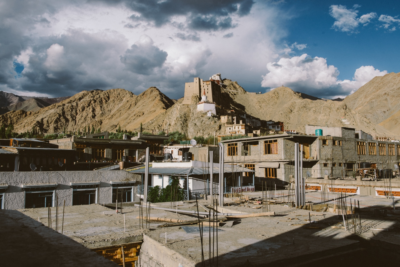 New development, accomodation and hotel construction sites surround the ancient Leh Palace, a site of historical significance for the Ladakhi people and the Buddhist community. The tourism industry in the state of Jammu & Kashmir, has increased exponentially since 1974, especially in the region of Ladakh, bringing urban development projects and modern technology, but also having an inverse affect on the local environment, such as putting a high demand on electricity, and negatively affecting the amount of clean drinking water due to Western flush toilets.