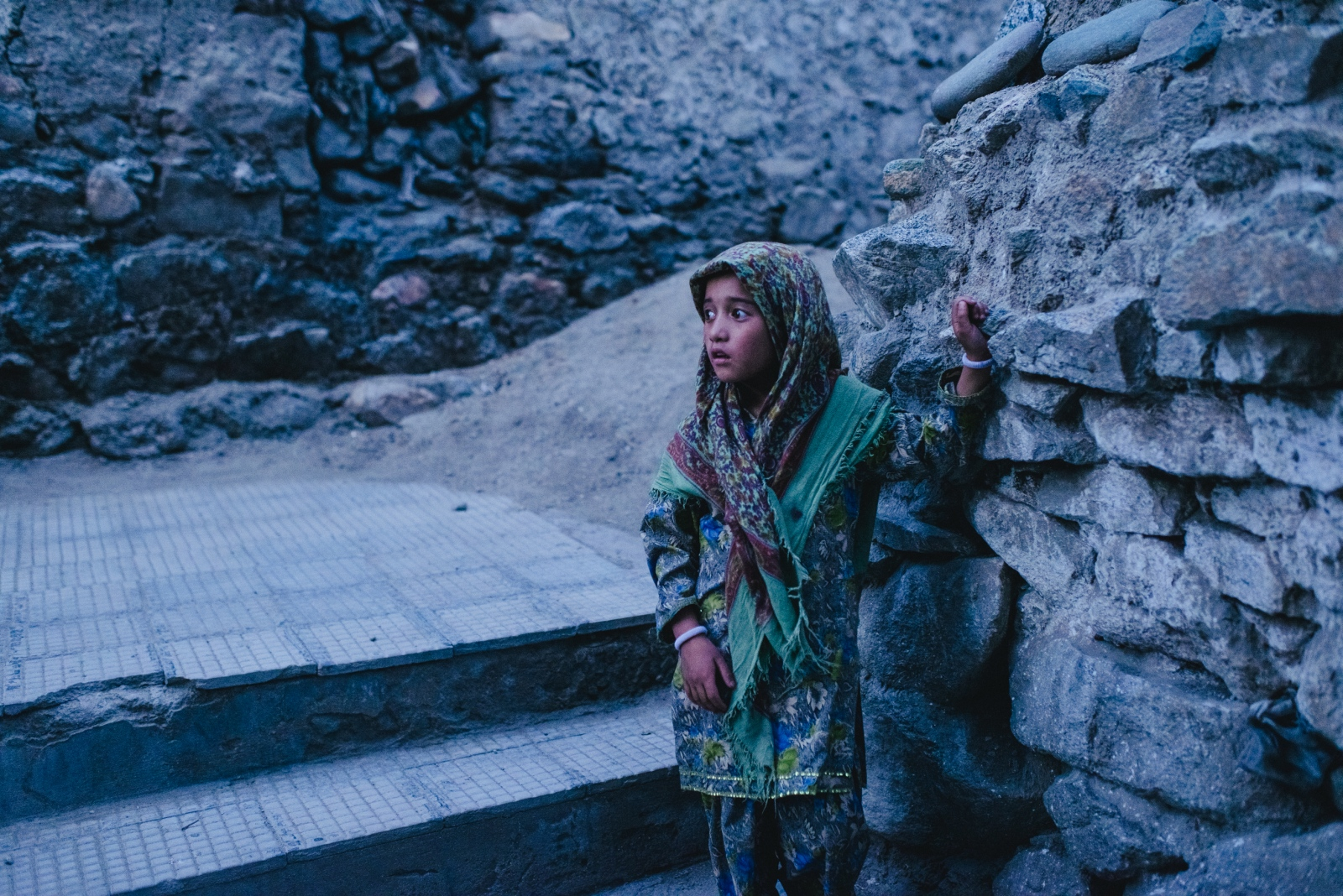 Jasmin, a young girl living in Leh, sells postcards to tourists on the narrow pathway from Jamia Masjid to Leh Palace.