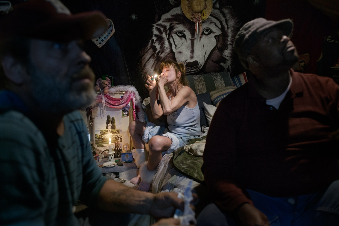 Various monthly government subsidies have come through for many in the camp and the group has pruchased several hundred dollars of crack. Dawn smokes while John and Bear wait their turn.