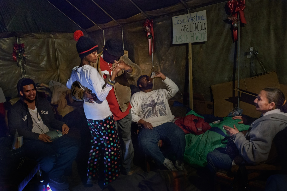 "Inside Tent City's chapel, ""Uncle Mike"" dances salsa with Eve."