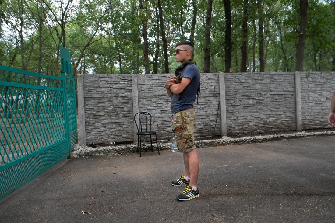 Kurakhove, Ukraine - A volunteer standing guard at the main gate of the Battalion Donbas base.