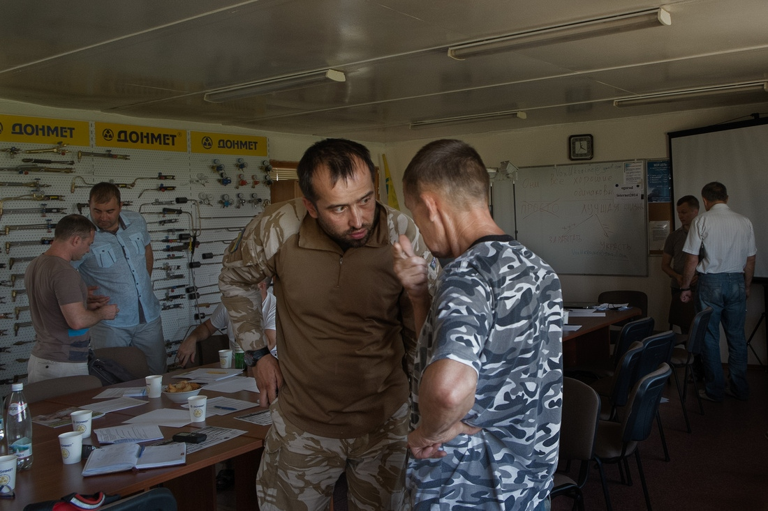 Pavel Kishkar, a commander with Battalion Donbas, attends a meeitng of local businees leaders. They are trying to develop an economic development plan once the war is over. Pavel says that the Battalion must become a political force to combat corruption.
