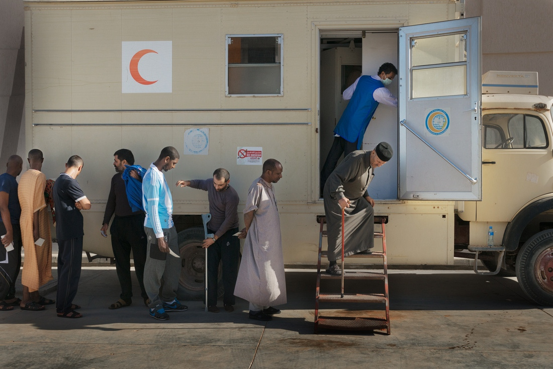 Misrata, Libya - Prisoners queue for chest x-rays provided by the National Center for Disease Control. .The Al-Jawiya Reform and Rehabilitation Center is the main detention center for former Ghadaffi loyalists and pro-Gadaffi fighters.