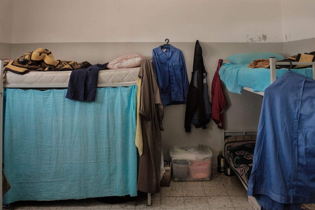 Misrata, Libya - Prisoners are allowed to receive food, books, and clothes from relatives during weekly visits. Approximately 8-10 prisoners share a the cell which has its own bathroom and shower.