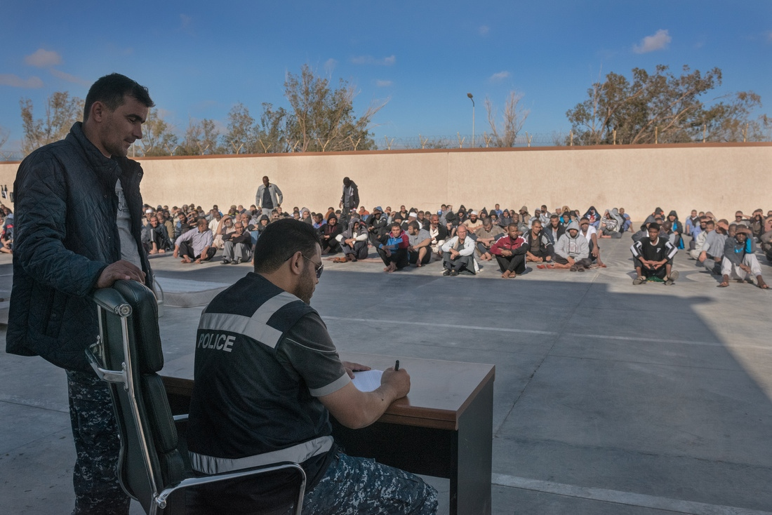 Misrata, Libya - Guards call up groups of prisoners for exams provided by the National Center for Disease Control. Guards reported that better health care and a prison commissary has made the prisoners more compliant.