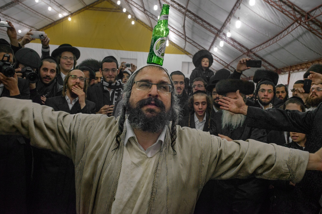 Rabbi Motta Frank, an influential Rabbi, celebrates on the final night of the Uman pilgrimage.