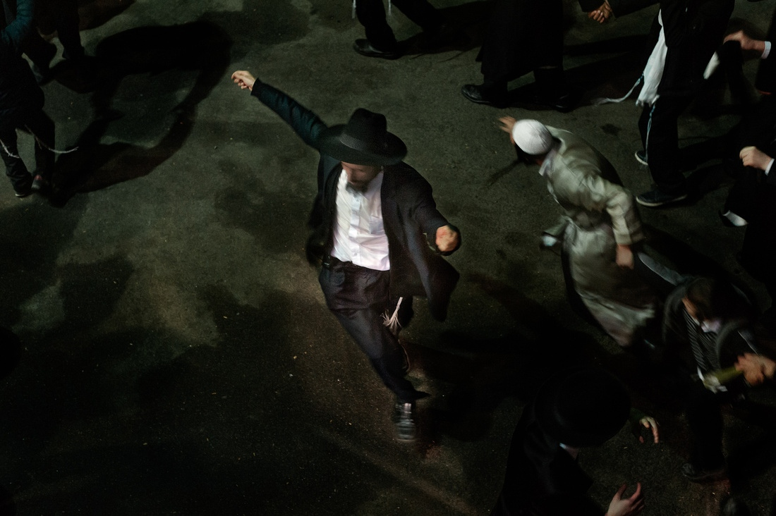 Breslover Hassidic Jews dance to klezmer music after Shabbos ends. This is the final night after of a weeklong pilgrimage to the grave of Rabbi Nachman for Rosh Hashanah.