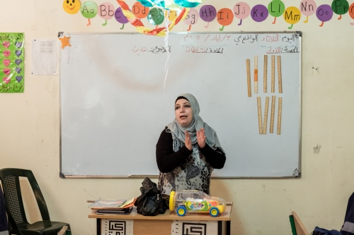 A Syrian teacher is giving a lesson at the Saadnayel School, a Non-Formal Education school, which provides quality learning environment.