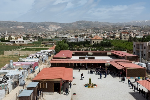 Aerial view of a refugee settlement and the Saadnayel School. In Lebanon, Syrian refugees live together in small scattered settlements, as no large refugee camps exist.