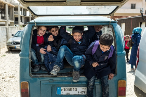 Transportation is organized to bring children back to their parents. Refugees settlements are scattered across the border region.