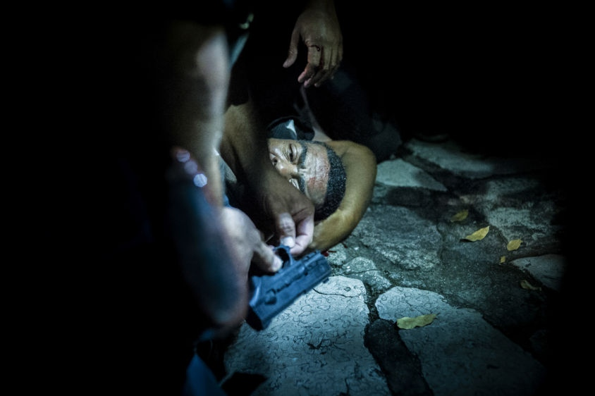 A police officer receives first aid after being attacked by rioters in Rio de Janeiro, Brazil, June 17, 2013. (AP Photo/Nicolas Tanner)