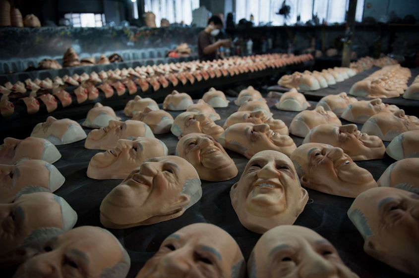 Olga Valles arranges Pope Francis masks as they dry at her family's Condal mask-making factory ahead of the pontiff's visit in Sao Goncalo near Rio de Janeiro, Brazil, Tuesday, July 9, 2013. The pope's July 22-29 visit to Brazil, the world's largest Roman Catholic country, will be his first foreign trip as pontiff. (AP Photo/Nicolas Tanner)