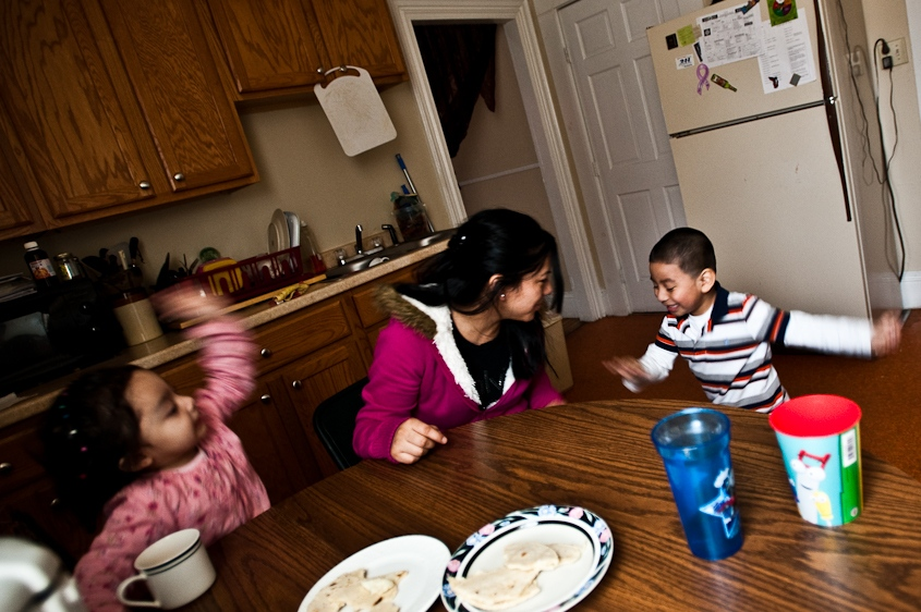 Isabel de Rosario tends to her son and step-daughter during lunch in Portland Maine on February 5th, 2011. De Rosario, a Guatemalan immigrant, had to move out of her house after incidents of domestic abuse against her and her children had put them at serious physical risk. Because they are undocumented, reporting the crimes to the police is impossible.