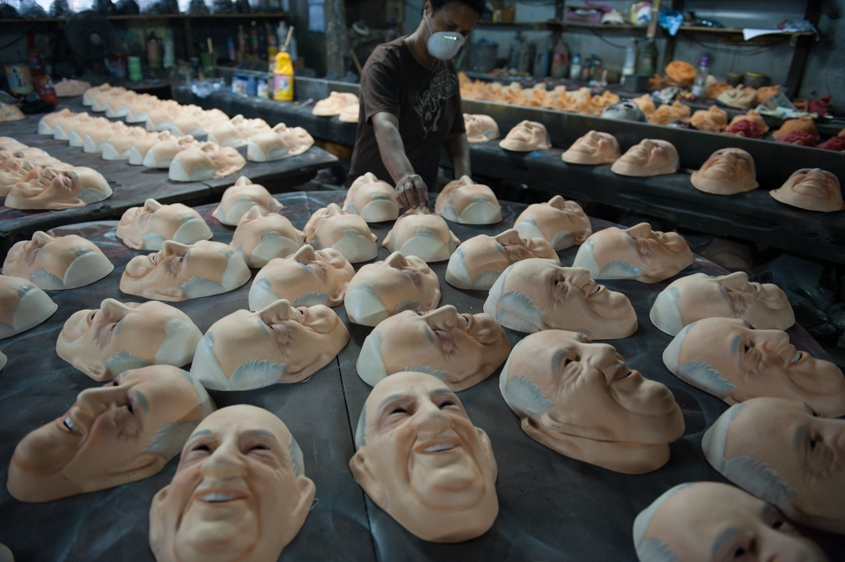 Olga Valles arranges Pope Francis masks as they dry at her family's Condal mask-making factory ahead of the pontiff's visit in Sao Goncalo near Rio de Janeiro, Brazil, Tuesday, July 9, 2013. The pope's July 22-29 visit to Brazil, the world's largest Roman Catholic country, will be his first foreign trip as pontiff.
