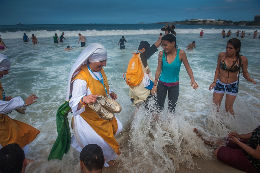 Nuns wade in the Copacabana beach water, in Rio de Janeiro, Brazil, Sunday, July 28, 2013. Pope Francis wrapped up a historic trip to his home continent Sunday with the World Youth Day's closing Mass on the Copacabana beachfront. He was leaving for Rome Sunday night.