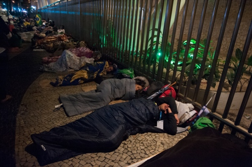 Pilgrims sleep on a sidewalk near Avenida Atlantica, next to Copacabana Beach in Rio de Janeiro, Brazil, Saturday, July 27, 2013.