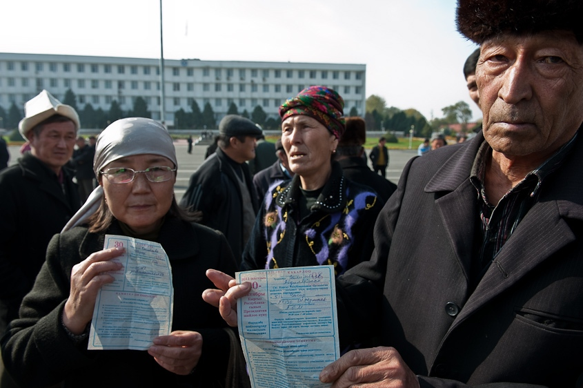Protestors hold up work documents outside of a polling station in Osh, Kyrgyzstan. November, 2011.